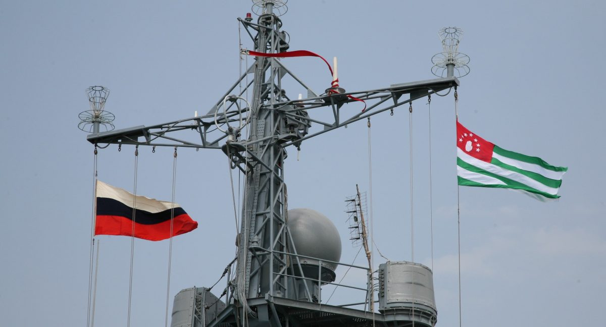 flags flying from a ship